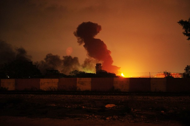 Fire and smokes erupted from a Pakistan' military air base after an attack by militants in Karachi on May 22, 2011.