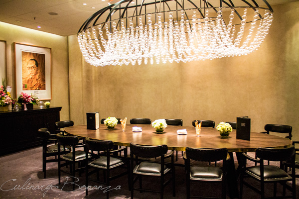 One of the private rooms at Auroz Gourmet Grill adorned with elaborate chandelier and painting of Indonesian founding fathers
