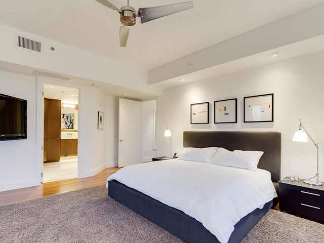 Photo of bedroom showing king sized bed