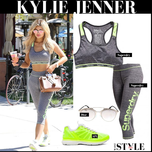 Kylie Jenner in grey sports bra, grey leggings and yellow sneakers workout style