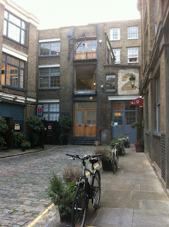 Possible ghost sign in Bleeding Heart Yard, London, EC2