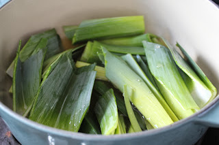 Simmering dark green leek parts