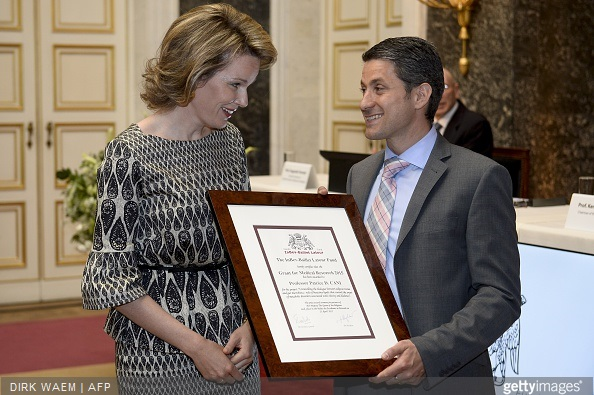 Queen Mathilde of Belgium speaks with Professor Patrice Cani who received the 2015 grant fo medical research during a ceremony for the Inbev-Baillet Latour awards for Health and Clinical Research in Brussels