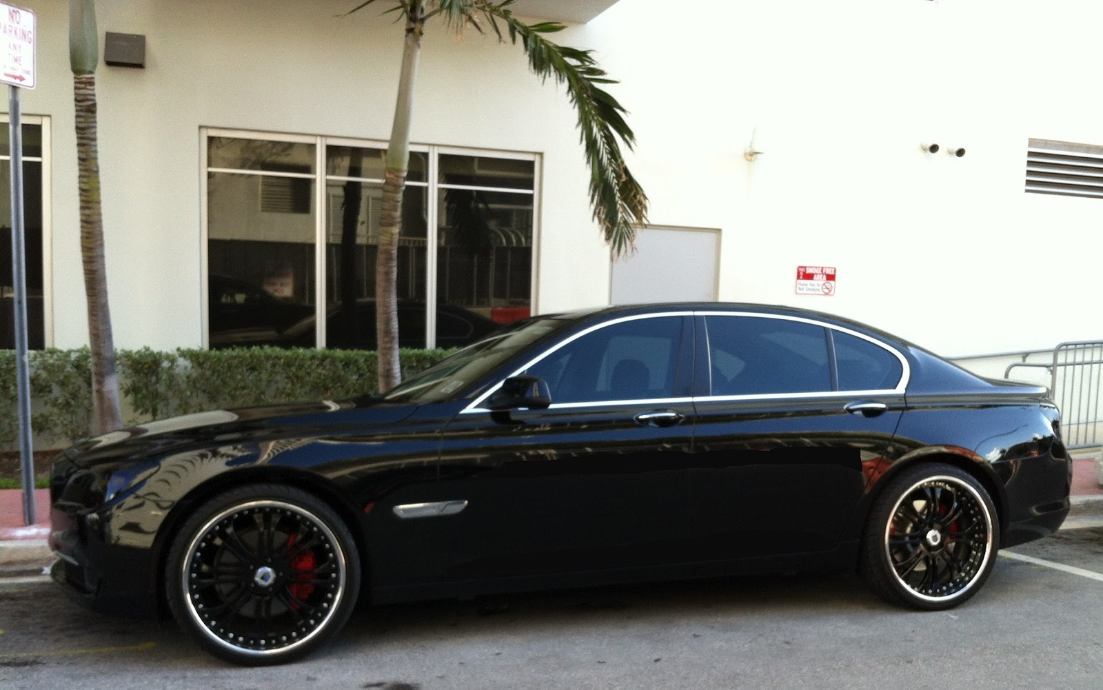 Black BMW 750 with black custom rims - Miami Beach ...