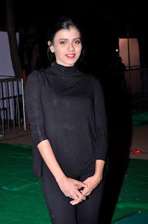 Hebah Patel in All Black Once again at Kumari 21F Audio Success Meet