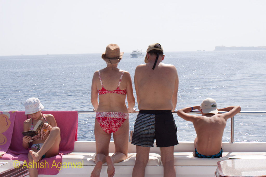 Family on a small tourist ship on the way to the Ras Muhammed marine park near Sharm el Sheikh