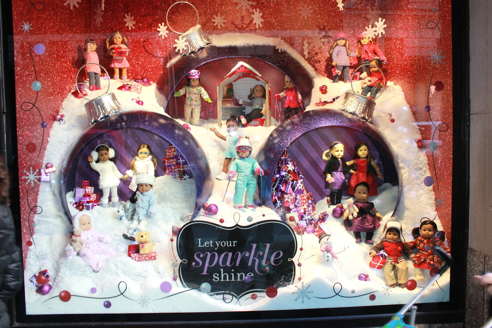 then a trip to new york is not complete without a visit to the flagship american girl store their windows feature beautiful dolls in holiday attire - Christmas Decorations For American Girl Dolls