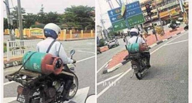 Dua Gambar Anggota Polis Trafik Membawa Tong Gas ini Menjadi Viral