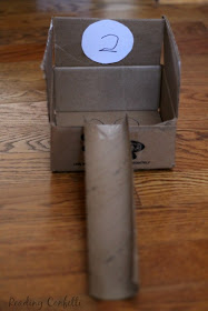A nine hole miniature golf course made from cardboard boxes. A great way to keep kids entertained while they're stuck inside and a fun way to learn about physics.