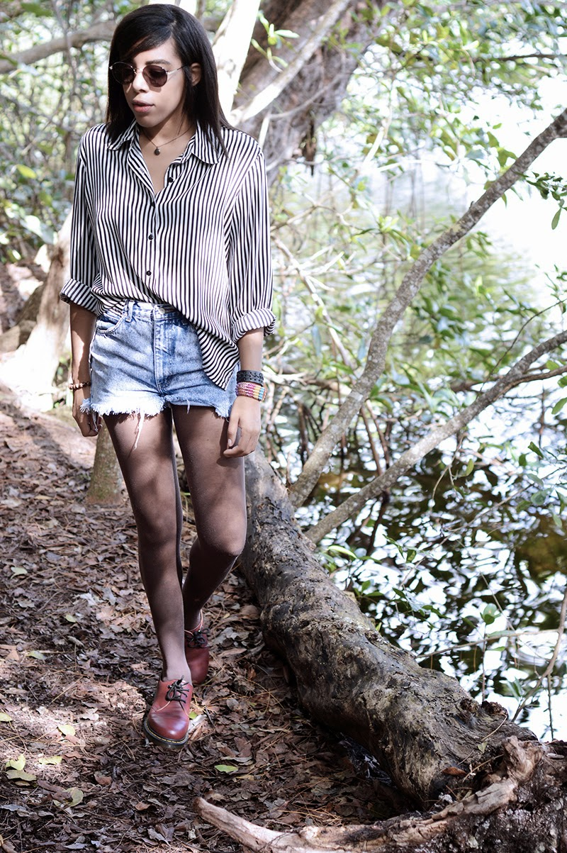 Miami fashion blogger Anais Alexandre of Down to Stars in an all vintage outfit hiking in the woods by a lake