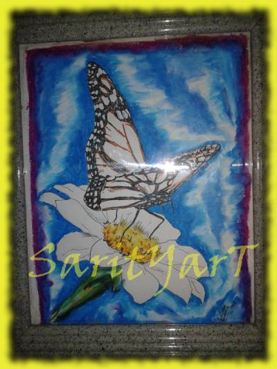 Mariposa combinando rotuladores con ceras blandas