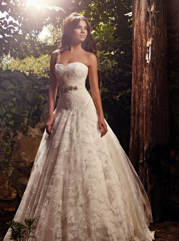 Check out some more trending wedding gowns 2014 here .