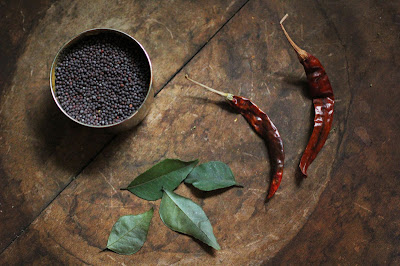 black mustard seeds, curry leaves, dried red chili