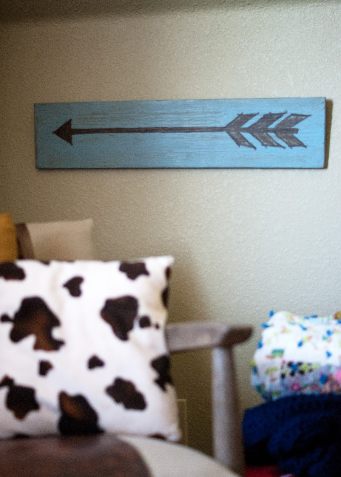 Arrow sign and cow print pillow