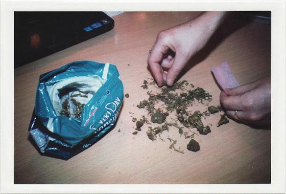 dirty photos - fumus - a photo of girl rolling marijuana