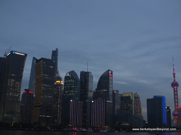 evening skyline from Huangpu River tour in Shanghai, China
