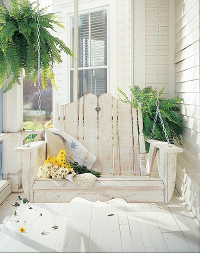 This whitewashed front porch swing is a great place to curl up with a book and enjoy the sunshine