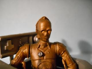 figura en miniatura del robot de la guerra de las galaxias c-3po
