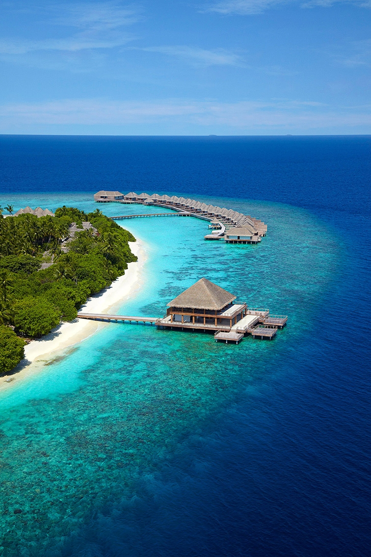 Wooden homes in Luxury Dusit Thani Resort in Maldives