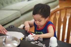 child playing with homemade playdough