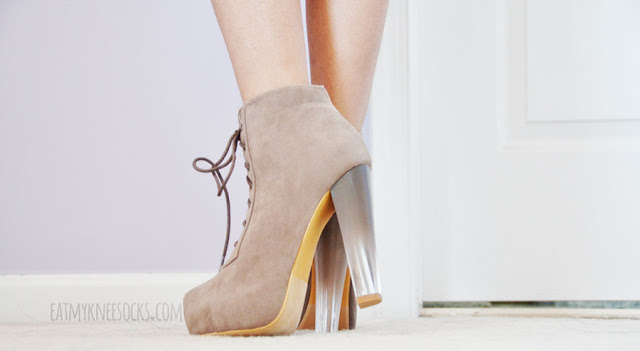 AMIClubwear's gradient-heel platform booties come in taupe and brown, with an ombre lucite heel, lace-up front, and side zipper.