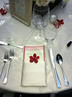 Red and white wedding table place setting - Photo by Patricia Stimac, Seattle Wedding Officiant