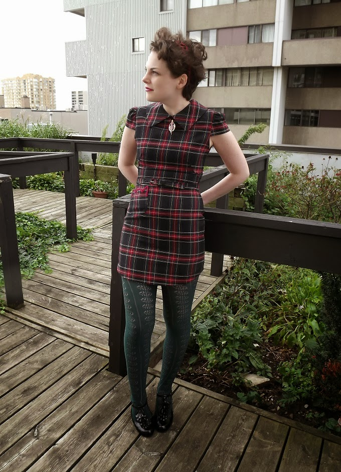 Rachel Antonoff, kitty pocket, plaid mini dress, holiday, Christmas, Victoria Park Place, pixie haircut, Modcloth, green tights, blogger model, Pocket Purr-fect, Mod You Look Necklace, tartan, A Coin For the Well, Suzanne Amlin