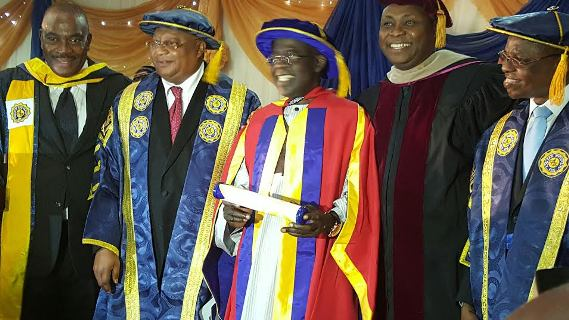 Bola ahmed Tinubu fixes his teeth as he gets honorary Doctorate degree from University.