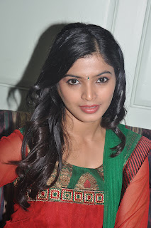 Sanchita Shetty Tamil Actress Spotted in Red at Kollaikaran press meet