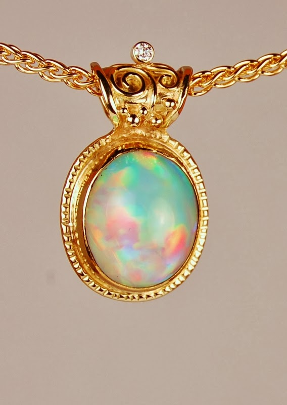 yellow gold pendant with large oval opal