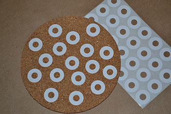 cork coaster with reinforment stickers for polka dots | Cordier Event Planning