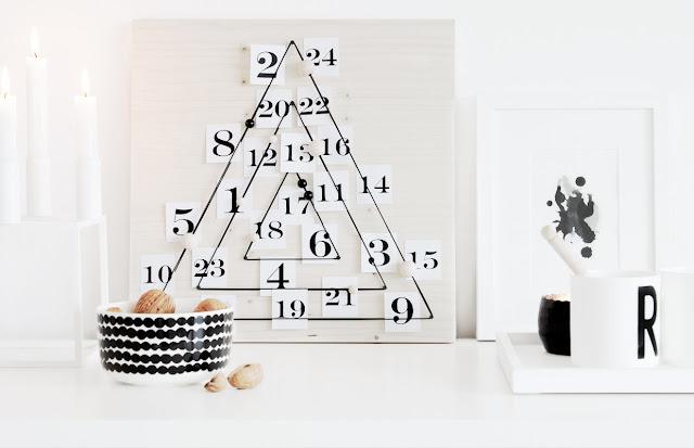 Adventskalender aus Sperrholz und Gummischnur