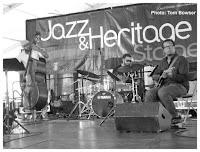 Junious Paul - Makaya McCraven - Jeff Parker - Makaya McCraven Quartet - 2015 Chicago Jazz Festival   Photograph by Tom Bowser
