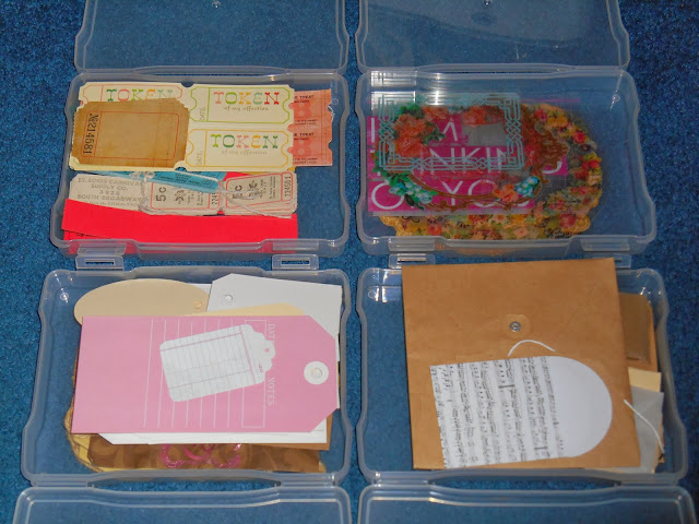 several small, clear storage containers filled with a variety of tickets, overlays, tags and envelopes