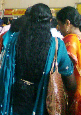 Software professional in traditional kerala hair style.