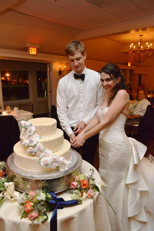Lauren and John cut their wedding cake