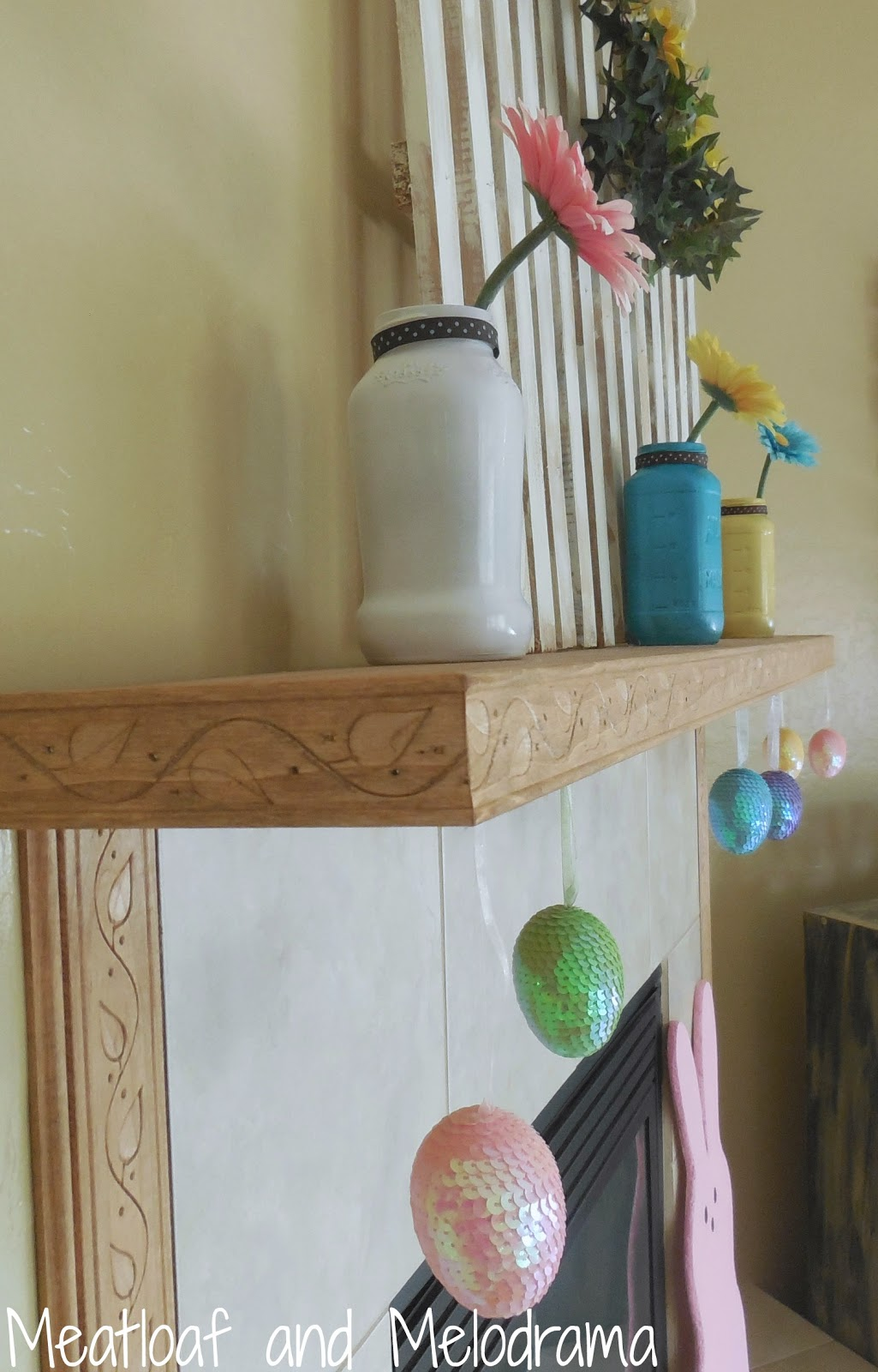 mason jar vases, Easter eggs and flowers on spring mantel