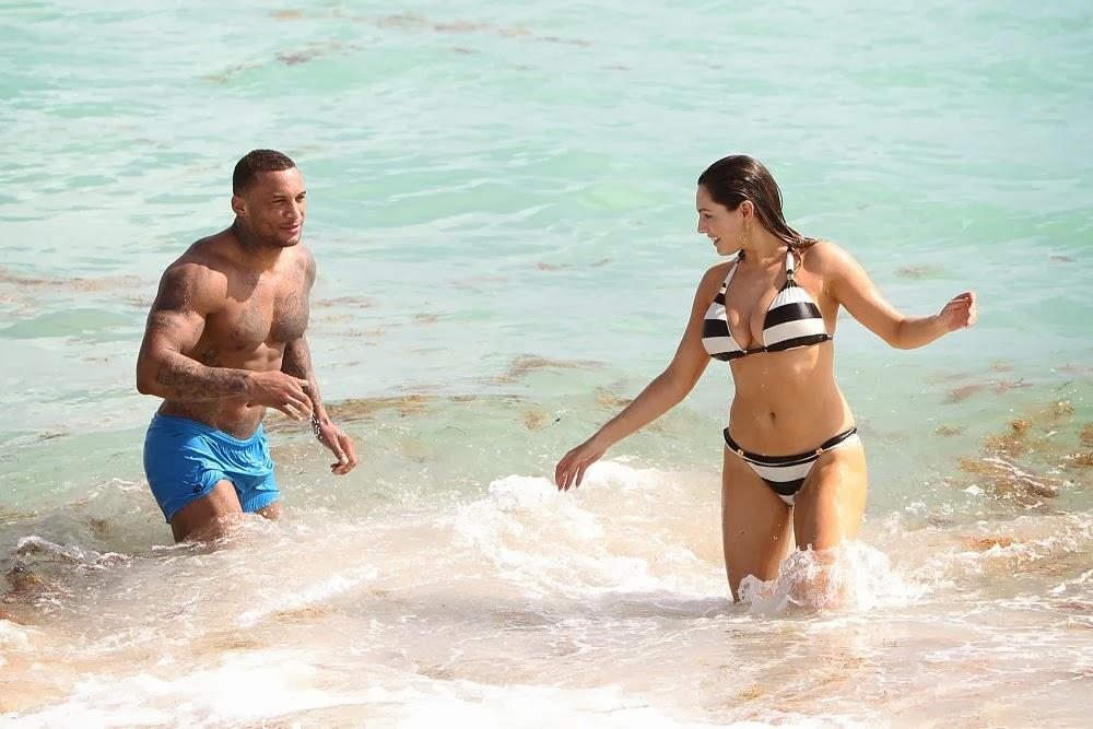 Kelly Brook seen in a black and white striped bikini with boyfriend in Miami