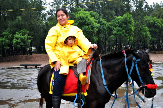 Mama and Kecil on horseback in Baguio