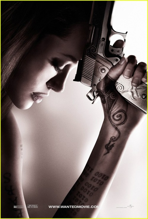 angelina jolie wanted tattoos pictures. angelina jolie wanted gun.