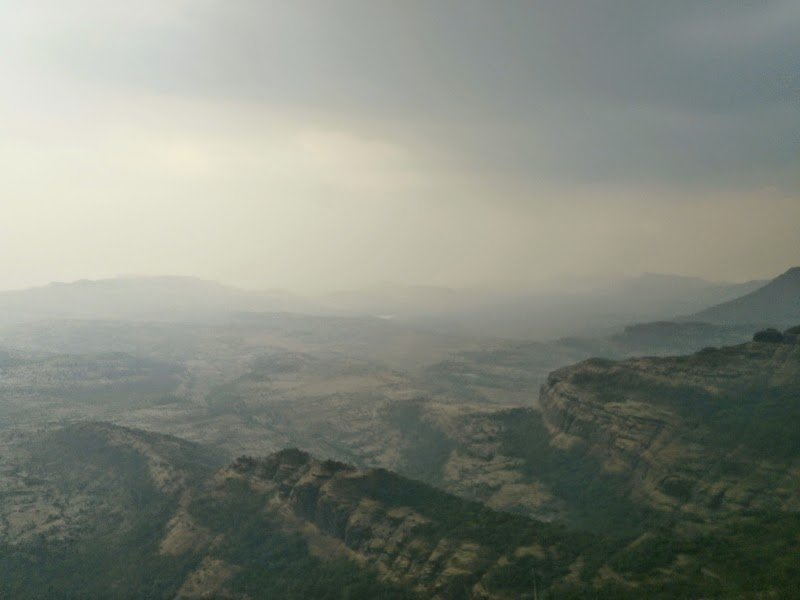 The view of base village Ambewadi on the plains below taken from the top of Alang