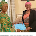 Mrs Saraki presents a report to Mrs Buhari