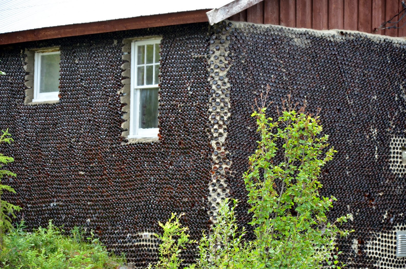 The glass house, made from glass bottles.