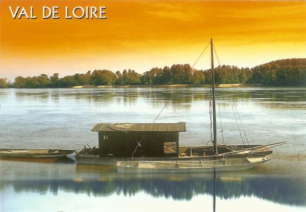 sunset on the Loire with river boat