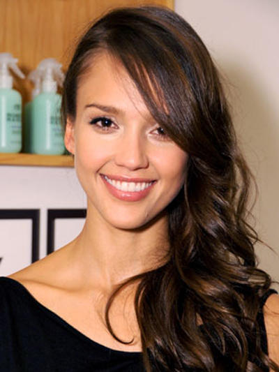 Soft flaring volume suits Jessica Alba's sultry side-swept hairstyle.