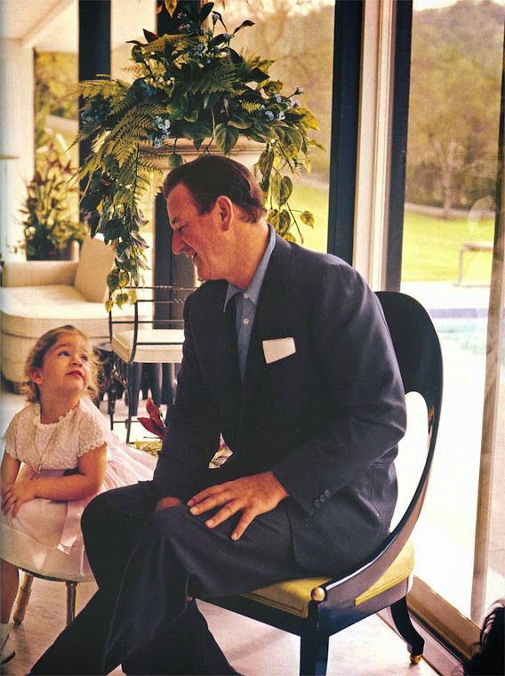 Duke and daughter in poolhouse.