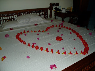 flower petals on bed in Kerala