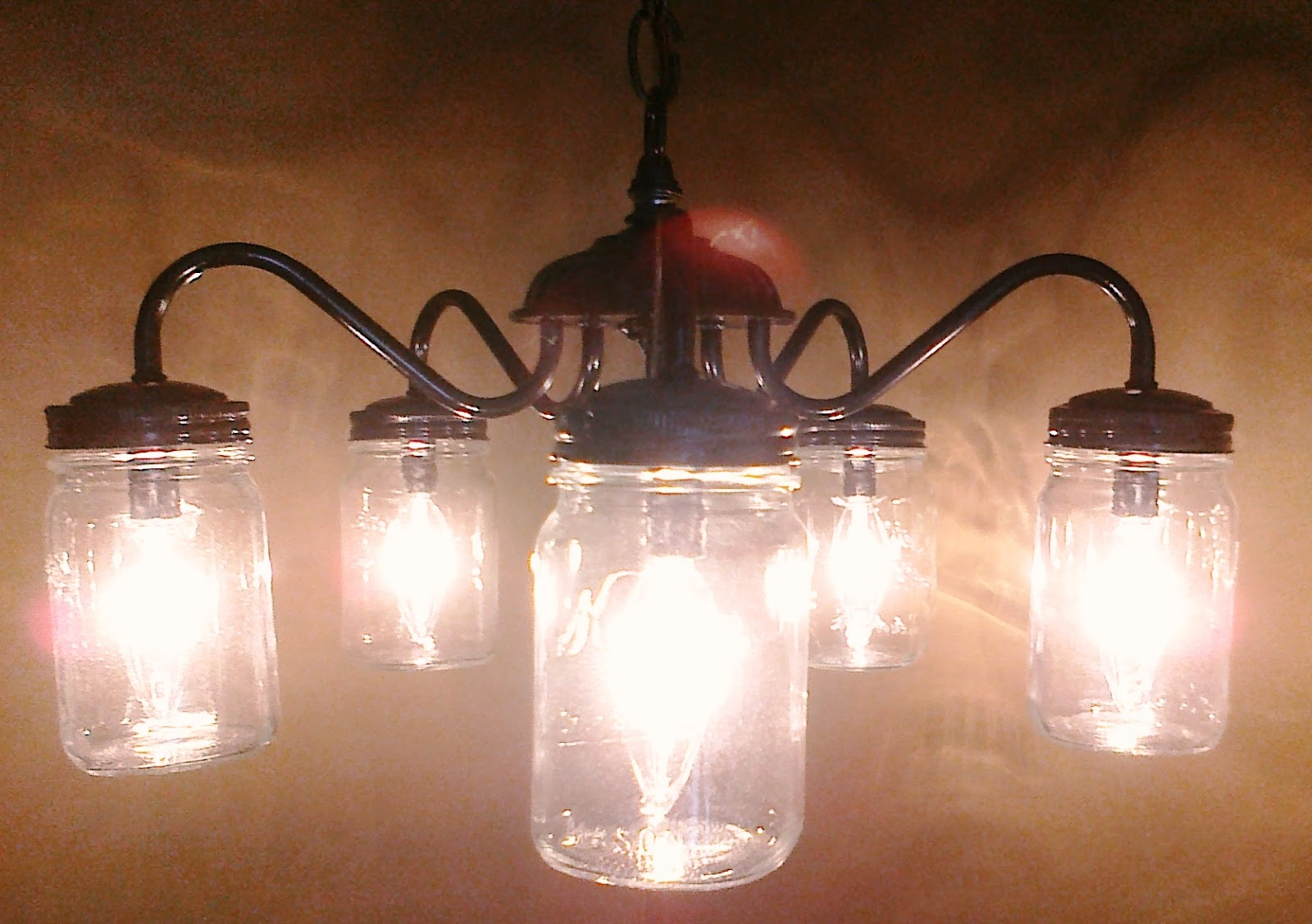 Make your own mason jar chandelier from an old light fixture make your own mason jar chandelier from an old light fixture arubaitofo Images