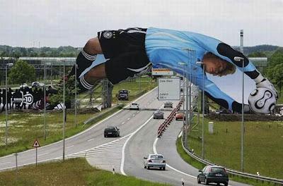Funny soccer player billboard.