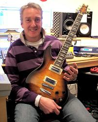 Steve Overland with Peavey guitar used on FM album METROPOLIS